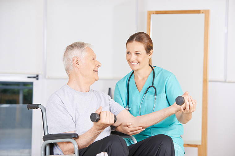 working out with therapist for stroke rehabilitation