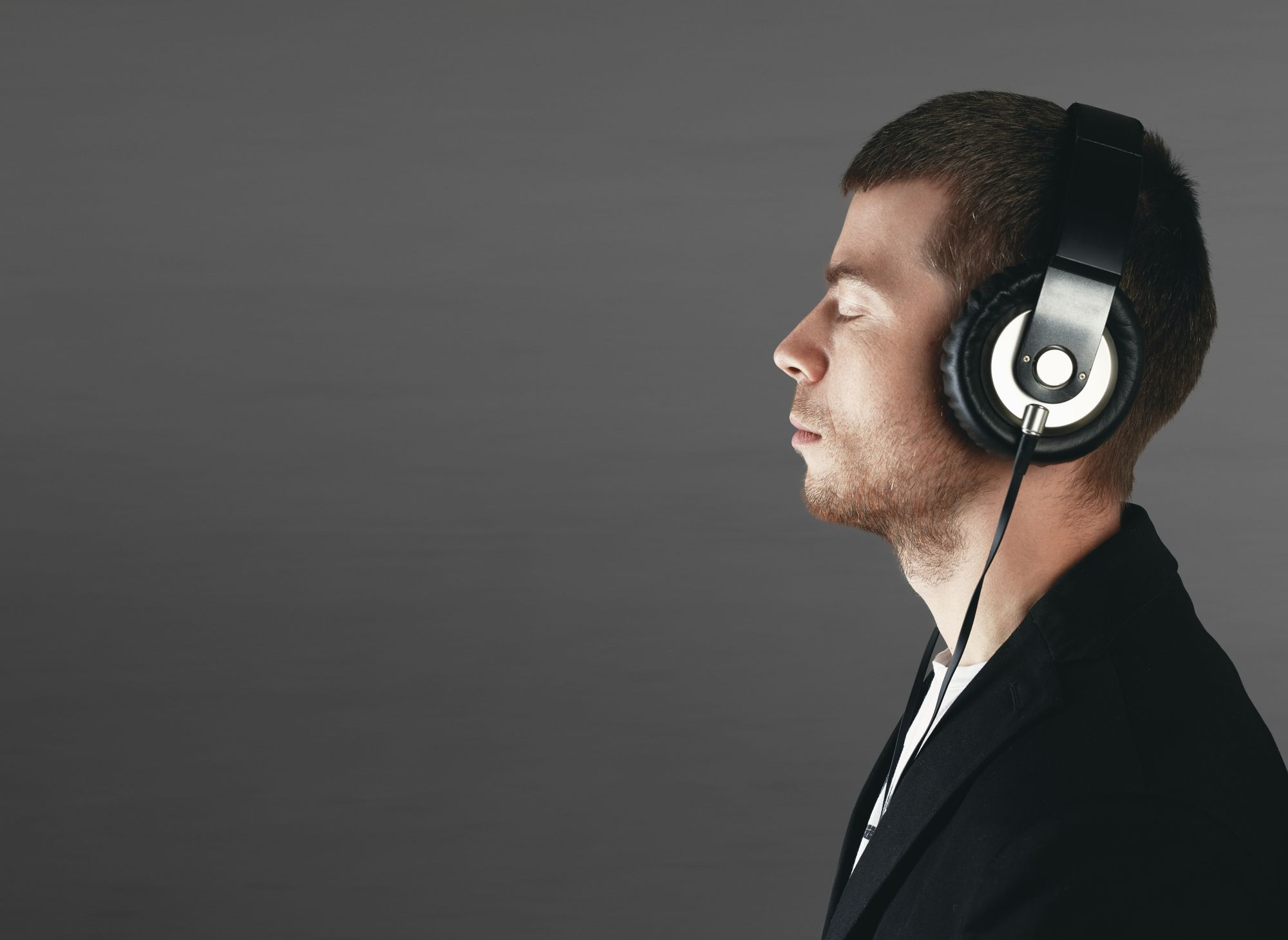 Man in headphones listening to mental practice recordings.