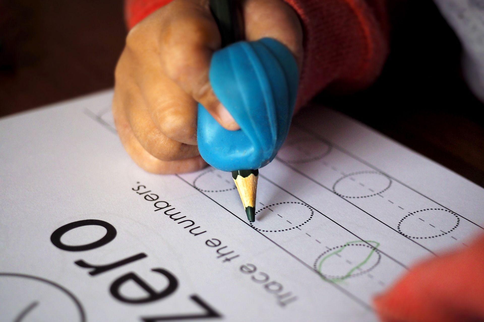 adaptive pencil grip by a school OT